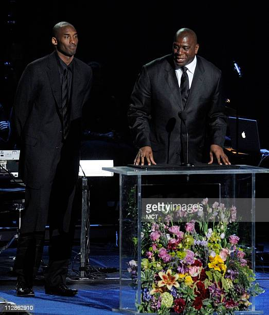 Los Angeles Lakers' Kobe Bryant and former Los Angeles Lakers' Magic Johnson speak at the Michael Jackson public memorial service held at Staples...