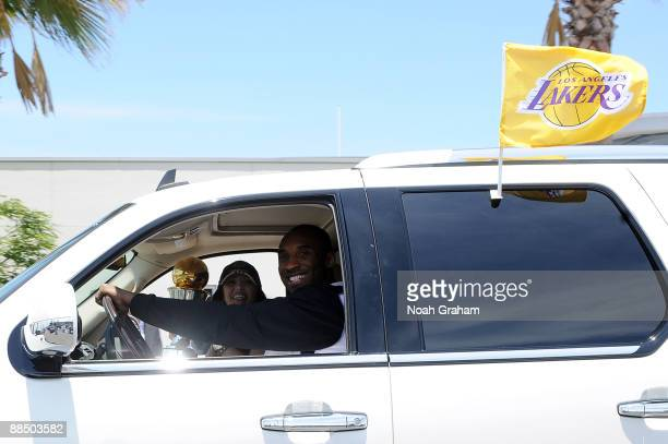 Los Angeles Lakers' Kobe Bryant and his wife Vanessa along with the NBA Finals MVP Trophy drive away after landing at LAX on June 15 2009 at Los...