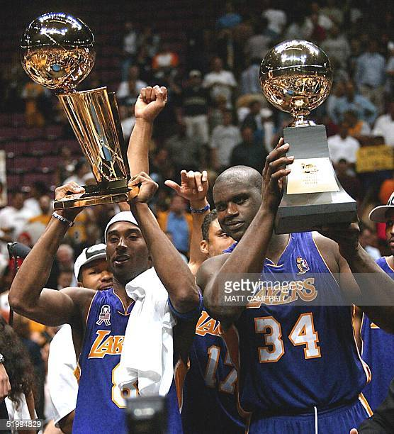 Los Angeles Lakers Kobe Bryant and Shaquille O'Neal hold up the Championship and MVP trophys after game four of the NBA Finals against the New Jersey...