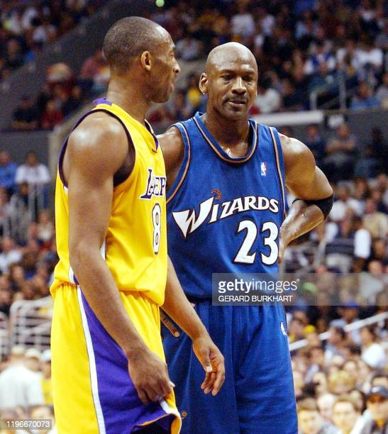 Los Angeles Lakers Kobe Bryant and Wizards Michael Jordan during the second quarter action after Bryant scored 40 points in Los Angeles CA 28 March...