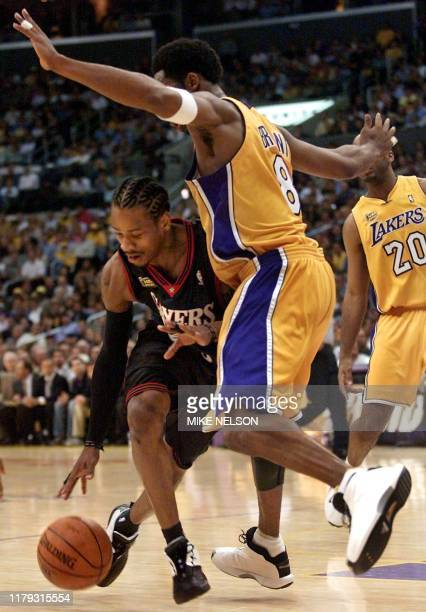 Los Angeles Lakers Kobe Bryant blocks Philadelphia 76ers Allen Iverson during the first half of the NBA Finals Game 1 at the Staples Center in Los...