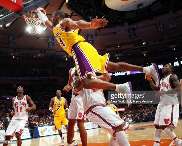 Los Angeles Lakers' Kobe Bryant drives to the basket during the second half of a game against the New York Knicks at Madison Square Garden Bryant...