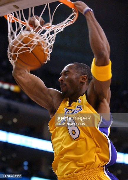 Los Angeles Lakers' Kobe Bryant dunks against the Seattle SuperSonics in the first quarter NBA action 07 January 2003 in Los Angeles CA AFP...