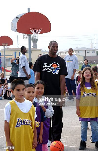 """Los Angeles Lakers' Kobe Bryant helps out during a basketball skills clinic as part of a surprise visit by the Lakers to kick off the 2006-07 """"NBA..."""