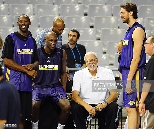 Los Angeles Lakers' Kobe Bryant Lamar Odom coach Phil Jackson and Paul Gasol from Spain chat during training session on October 6 2010 at Palau Sant...