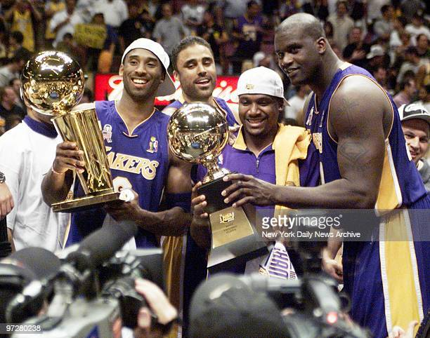 Los Angeles Lakers' Kobe Bryant Rick Fox Lindsey Hunter and Shaquille O'Neal hold their trophies before the media after capturing the 2002 NBA...