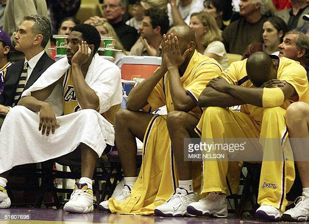 Los Angeles Lakers Kobe Bryant Sean Rooks and Ruben Patterson sit on the bench as the Western Conference semifinal against the San Antonio Spurs 23...