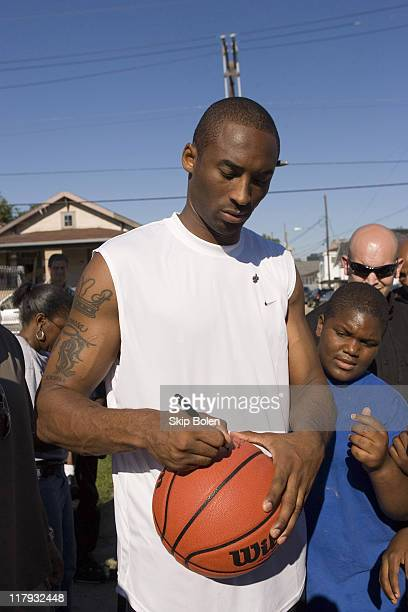 Los Angeles Lakers Kobe Bryant signs autographs for the local kids in Central City, New Orleans