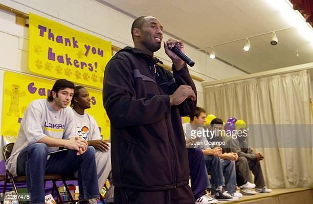 """Los Angeles Lakers' Kobe Bryant speaks to students during a surprise visit by the Lakers to kick off the 2006-07 """"NBA Cares"""" season on October 25,..."""