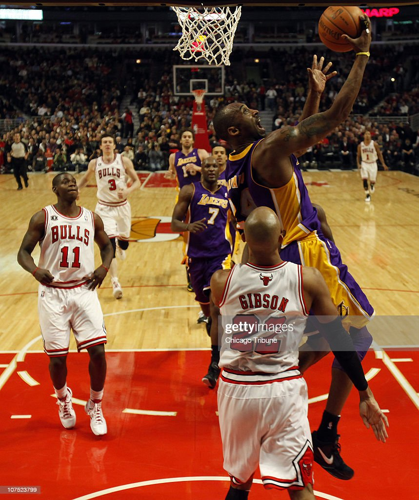 Los Angeles Lakers' Kobe Bryant, top, goes to the basket against the Chicago Bulls' Taj Gibson (22) at the United Center in Chicago, Illinois, on Friday, December 10, 2010. The Bulls defeated the Lakers, 88-84.