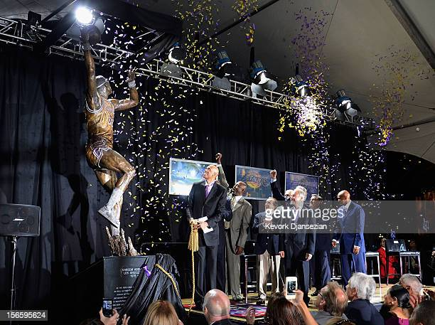 Los Angeles Lakers legend Kareem AbdulJabbar unveils a statue of himself as his former with his legendary teammates looking on at Staples Center on...