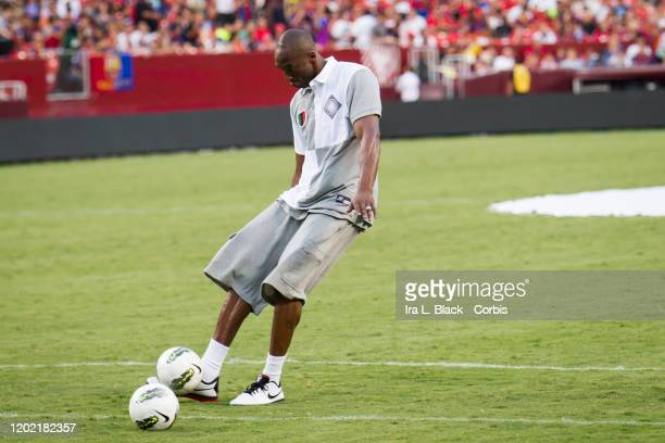Los Angeles Lakers legend Kobe Bryant kicks the ball and takes a shot on goal the during the halftime session with him kicking some soccer balls...