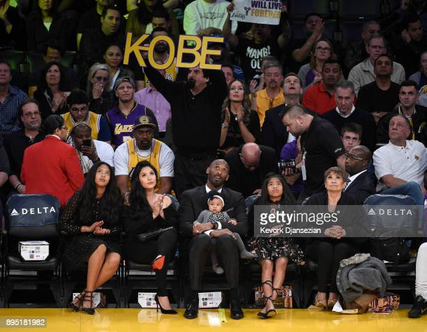 Los Angeles Lakers legend Kobe Bryant seated courtside with his family looks on during a basketball game between the Golden State Warriors and Los...