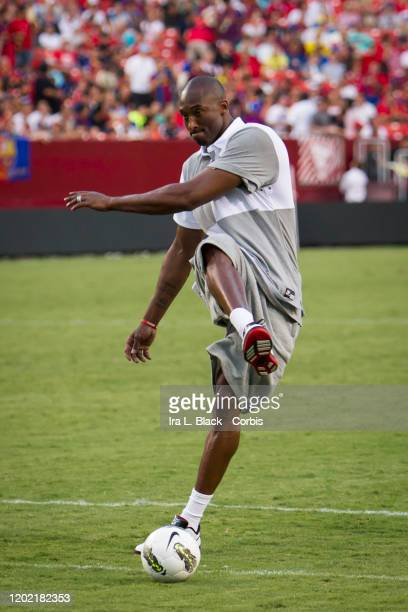 Los Angeles Lakers legend Kobe Bryant watches his shot on goal the during the halftime session with him kicking some soccer balls during the...