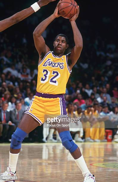 Los Angeles Lakers' Magic Johnson looks to pass during a game NOTE TO USER User expressly acknowledges and agrees that by downloading and/or using...