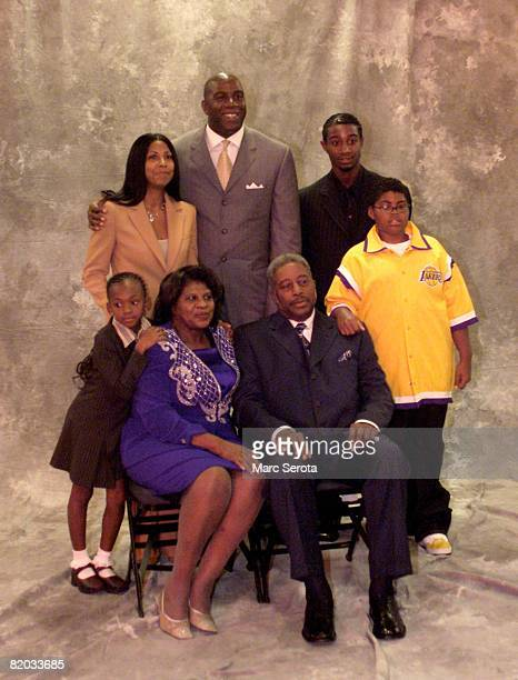 Los Angeles Lakers Magic Johnson poses for photos with family members including his wife Cookie mother and father and three children on September 27...