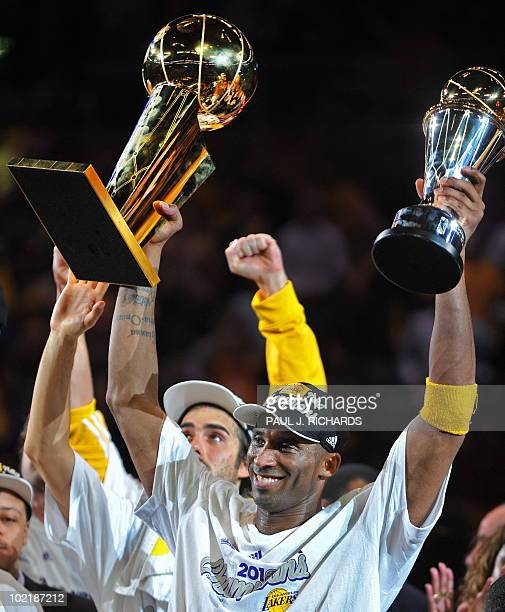 Los Angeles Lakers MVP Kobe Bryant hoids the team and MVP trophies after the Lakers defeated the Boston Celtics in Game 7 of the 2010 NBA Finals to...