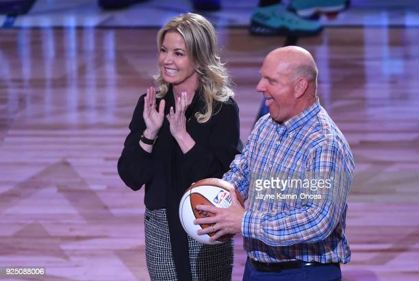 Los Angeles Lakers owner Jeannie Buss and Los Angeles Clippers owner Steve Ballmer wait to hand off the ball to former NBA player and Charlotte...