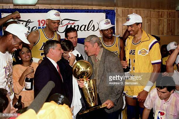 Los Angeles Lakers Owner Jerry Buss and the Los Angeles Lakers celebrate in the locker room after winning the 1987 NBA Finals against the Boston...