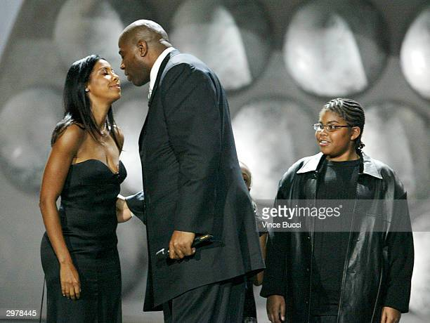 Los Angeles Lakers player Earvin Magic Johnson greets his wife Cookie as his son Earvin III watches onstage at The Rewarding Life of Earvin Johnson...
