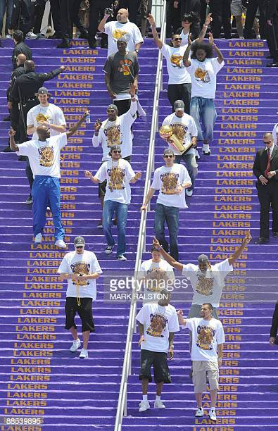 Los Angeles Lakers players celebrate as they arrive for a victory parade at the Coliseum stadium in Los Angeles after defeating the Orlando Magic in...