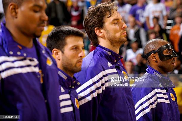 Los Angeles Lakers players from left Andrew Bynum Jason Kapono Pau Gasol and Kobe Bryant stand during the National Anthem before playing against the...