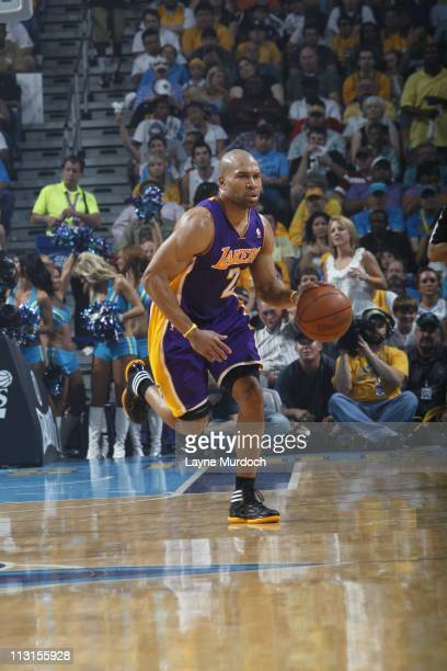 Los Angeles Lakers point guard Derek Fisher brings the ball up court during the action against the New Orleans Hornets in Game Four of the Western...
