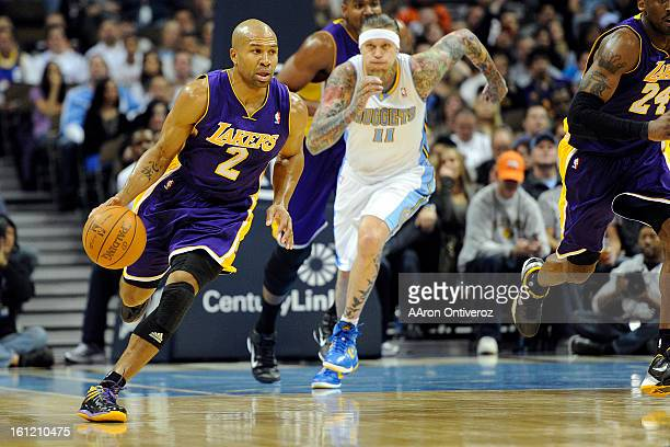 Los Angeles Lakers point guard Derek Fisher brings the ball up court as Denver Nuggets center Chris Andersen pursues during the first quarter at the...