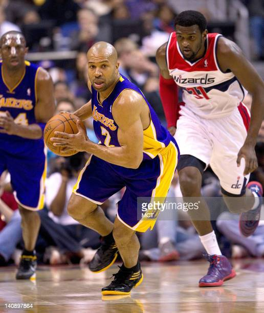 Los Angeles Lakers point guard Derek Fisher brings the ball up the court while being chased by Washington Wizards small forward Chris Singleton...