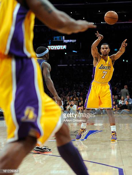 Los Angeles Lakers point guard Ramon Sessions passes to shooting guard Kobe Bryant during the first half of game two of their opening round NBA...