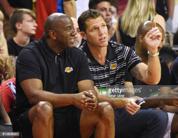 Los Angeles Lakers president of basketball operations Earvin Magic Johnson and head coach Luke Walton of the Lakers talk during a 2017 Summer League...