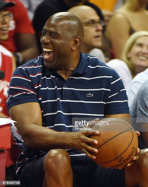 Los Angeles Lakers president of basketball operations Earvin 'Magic' Johnson smiles during the team's championship game of the 2017 Summer League...