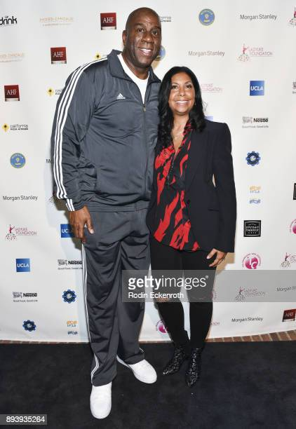 NBA Los Angeles Lakers president of basketball operations Magic Johnson and philanthropist / businesswoman Cookie Johnson pose for portrait at the...