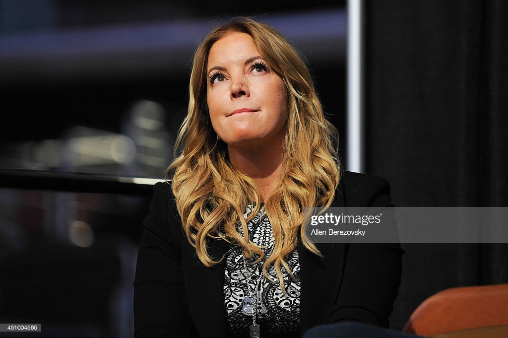 Los Angeles Lakers president of business operations Jeanie Buss watches a video tribute to her father Jerry Buss on the jumbotron during the Los Angeles Sports and Entertainment Commission's 10th annual Lakers All-Access event at Staples Center on November 20, 2013 in Los Angeles, California.
