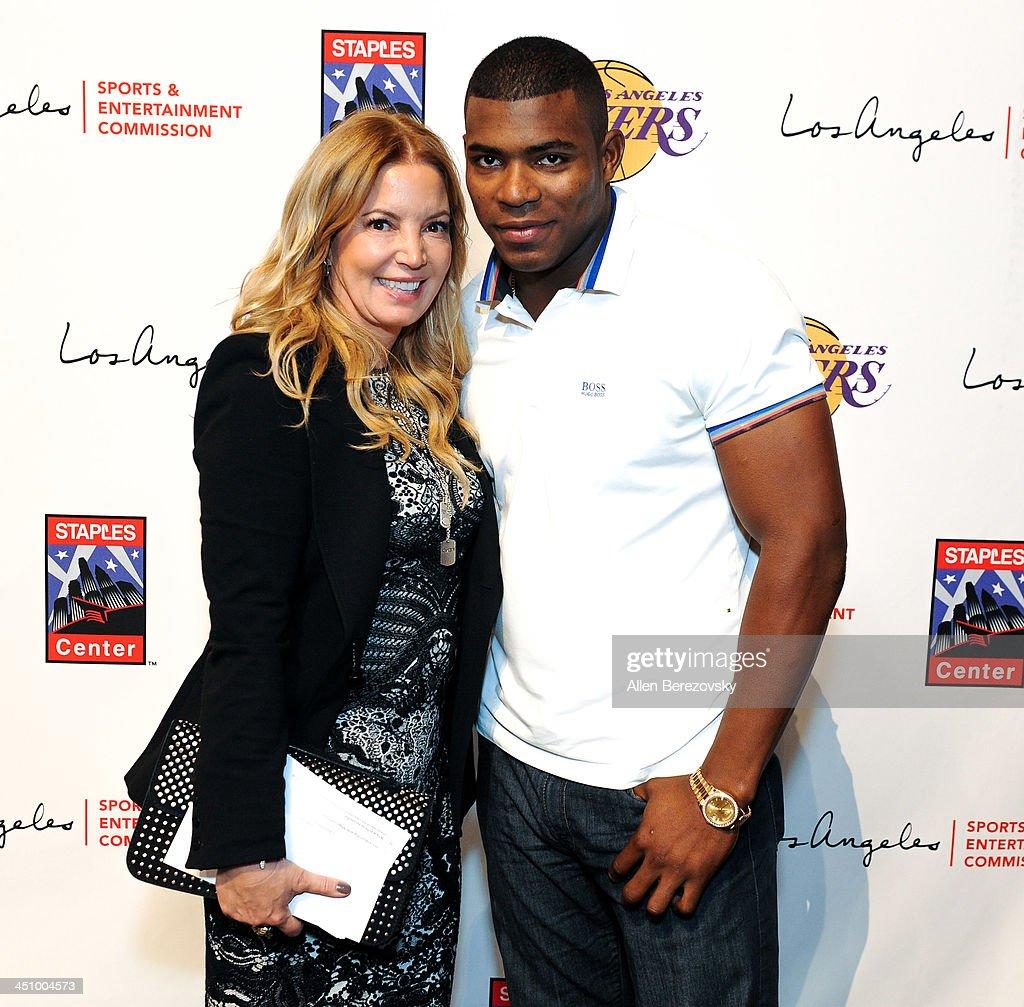Los Angeles Lakers president of business operations Jeanie Buss and Los Angeles Dodgers baseball player Yasiel Puig attend the Los Angeles Sports and Entertainment Commission's 10th annual Lakers All-Access event at Staples Center on November 20, 2013 in Los Angeles, California.