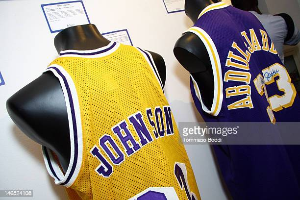 Los Angeles Lakers replica home jersey signed by Magic Johnson and a Los Angeles Lakers replica away jersey signed by Kareem Abdul-Jabbar are...