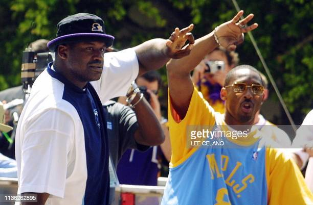 Los Angeles Lakers' Shaquille O'Neal and Kobe Bryant hold up three fingers to indicated the three consecutive NBA Finals Championships which the...