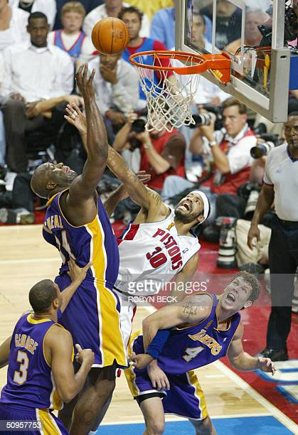 Los Angeles Lakers Shaquille O'Neal Devean George and Luke Walton challenge Rasheed Wallace of the Detroit Pistons under the net during second half...