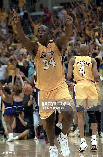 Los Angeles Lakers Shaquille O'Neal raises his hands after scoring two points against Portland Trail Blazers at the end of game seven of their NBA...