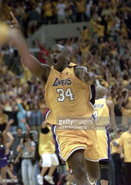 Los Angeles Lakers' Shaquille O'Neal raises his hands after scoring two points against the Portland Trail Blazers at the end of game seven of their...
