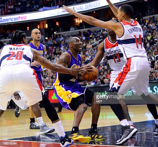 Los Angeles Lakers shooting guard Kobe Bryant attempts to work in the lane while surrounded by Washington Wizards power forward Cartier Martin...
