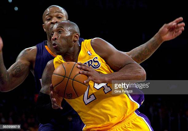 Los Angeles Lakers shooting guard Kobe Bryant drives to the basket and gets fouled by Phoenix Suns small forward PJ Tucker in the first half at...