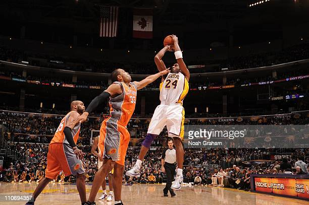 Los Angeles Lakers shooting guard Kobe Bryant goes for a jump shot during a game against the Phoenix Suns at Staples Center on March 22 2011 in Los...