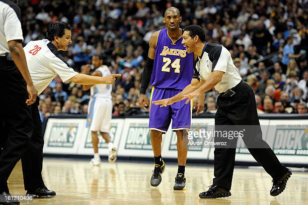 Los Angeles Lakers shooting guard Kobe Bryant listens as the referees discuss a call against the Lakers during the second quarter at the Pepsi Center...