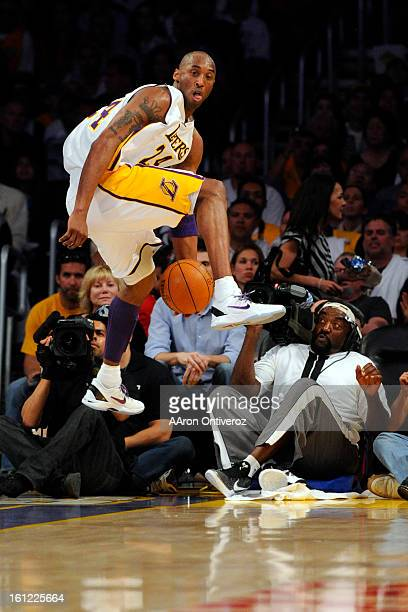 Los Angeles Lakers shooting guard Kobe Bryant saves a ball against the Denver Nuggets during an opening round NBA playoff game at the Staples Center...