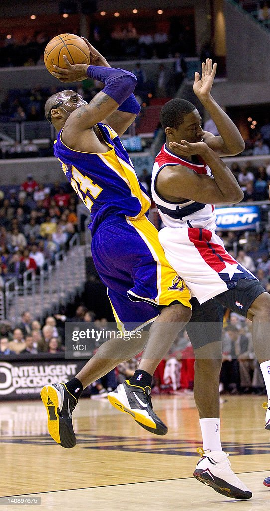 Los Angeles Lakers shooting guard Kobe Bryant (24) shoots and scores after being fouled by Washington Wizards shooting guard Jordan Crawford (15) during the first half of their game played at the Verizon Center in Washington, D.C., Wednesday, March 7, 2012.