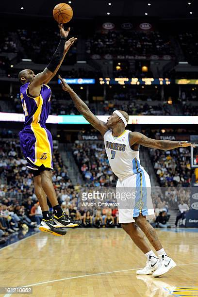 Los Angeles Lakers shooting guard Kobe Bryant shoots over Denver Nuggets power forward Al Harrington during the second quarter at the Pepsi Center on...