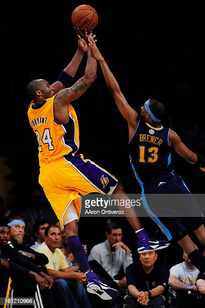 Los Angeles Lakers shooting guard Kobe Bryant shoots over Denver Nuggets small forward Corey Brewer during the second half of game two of their...
