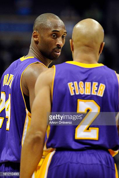 Los Angeles Lakers shooting guard Kobe Bryant speaks with teammate Derek Fisher during the second quarter at the Pepsi Center on Sunday January 1...