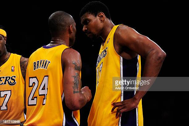 Los Angeles Lakers shooting guard Kobe Bryant talks to center Andrew Bynum during the second half of game two of their opening round NBA Playoffs...